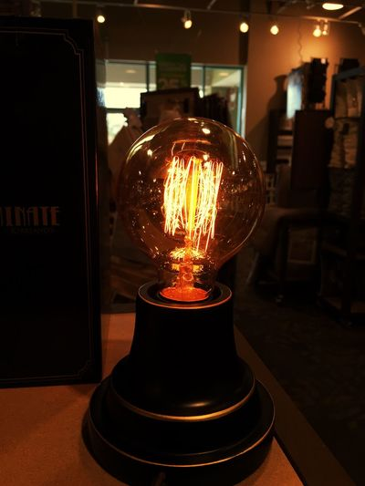 Old bulb in an old things store Illuminated Indoors  Light Bulb Electricity  Close-up Glowing Diminishing Perspective Modern Vintage Antique Oldthings