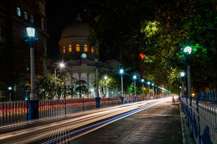 Illuminated Light Trails On Street In City At Night