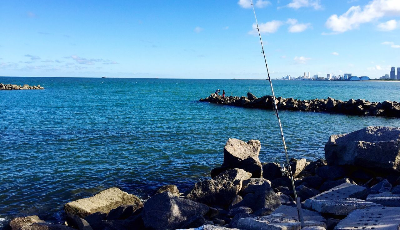 sea, water, sky, horizon over water, nature, scenics, beauty in nature, rock - object, tranquil scene, tranquility, day, outdoors, cloud - sky, blue, no people
