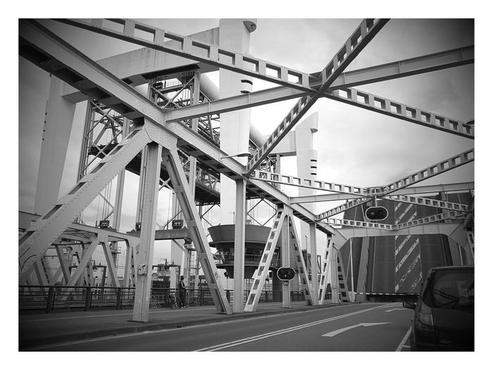 Just A Wait For The Closed Bridge 🤗 Sky Industry Day City Outdoors Railroad Track Public Transportation Built Structure Architecture Black & White HuaweiP9 Plus Photography EyeEmNewHere B Bridge Over Water Bridge - Man Made Structure Bridge Construction Bridgeview No People HuaweiP9 Plus Photography The Week On EyeEm The Still Life Photographer - 2018 EyeEm Awards