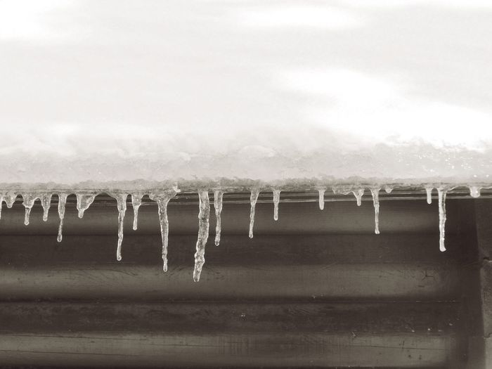 Black & White Black And White Black And White Photography Close-up Cold Cold Days Cold Temperature Day Detail Frozen Ice Icicle Icicles Nature No People Outdoors Roof Sky Snow Snow ❄ Water Winter Winter Wooden House Shades Of Winter