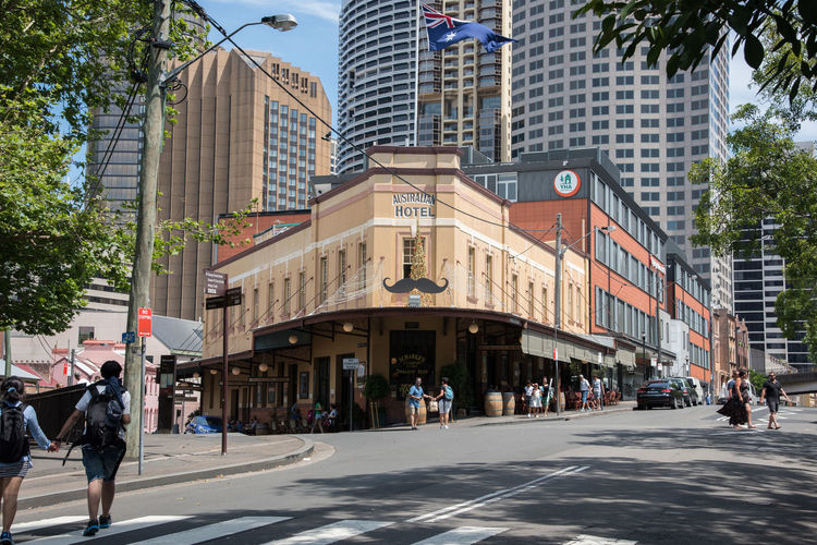 Sydney,NSW,Australia-November 20,2016: The Australian Heritage Hotel with moustache, Christmas tree and tourists on George Street in the Rocks District of Sydney, Australia Australia Moustache Pub Quaint  The Australian Heritage Hotel The Rocks Architecture Australian Hotel Character Charm Christmas Tree City City Life Edwardian Hotel Modern Pedestrian People Real People Restaurant Road Skyscraper Street Sydney Walking