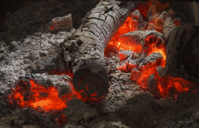 High angle view of fire on wood