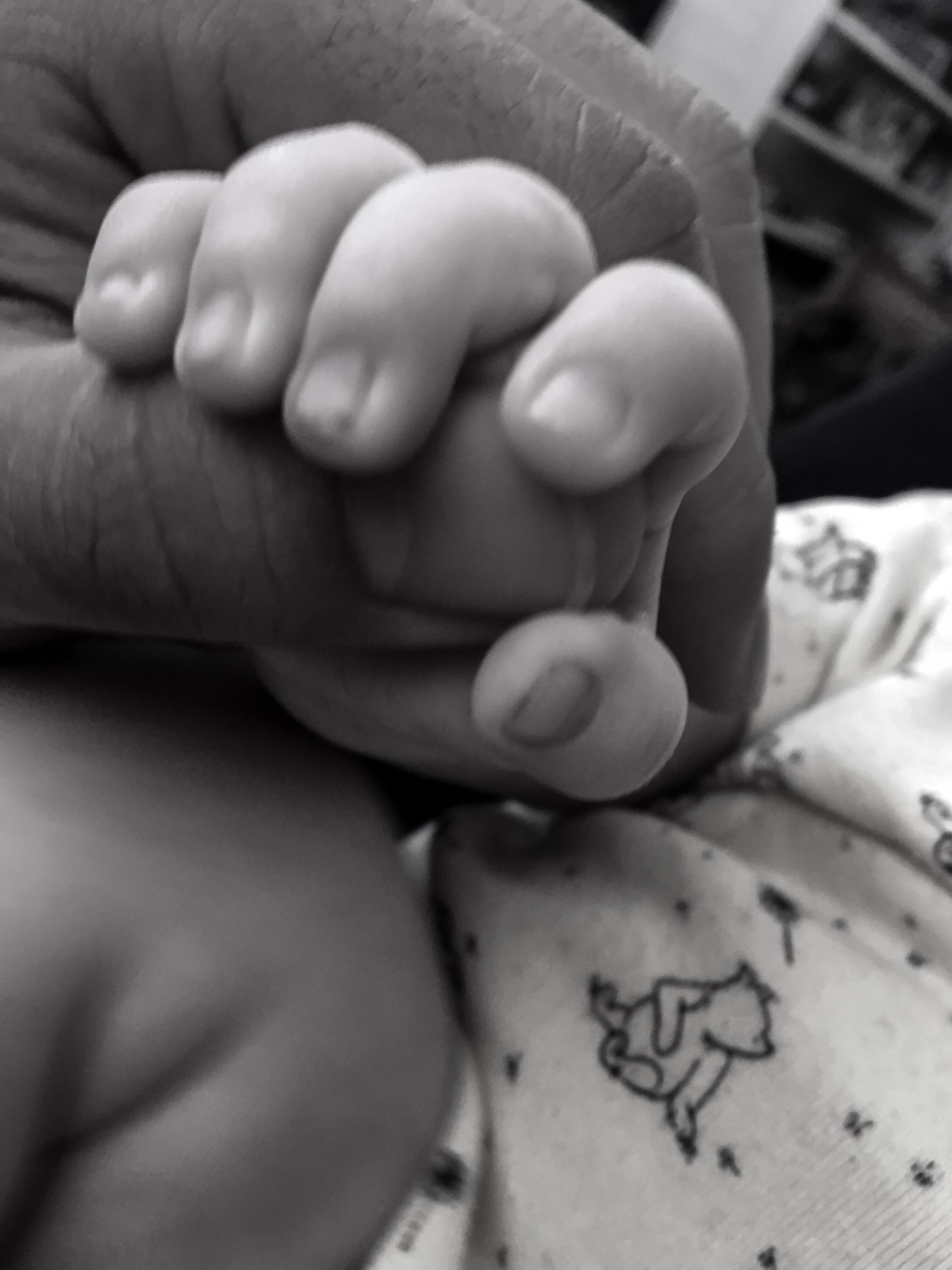 person, indoors, love, close-up, bonding, holding, togetherness, part of, baby, human finger, leisure activity, lifestyles, father, family with one child, care, babyhood, unknown gender, family, toddler, focus on foreground, selective focus, personal perspective