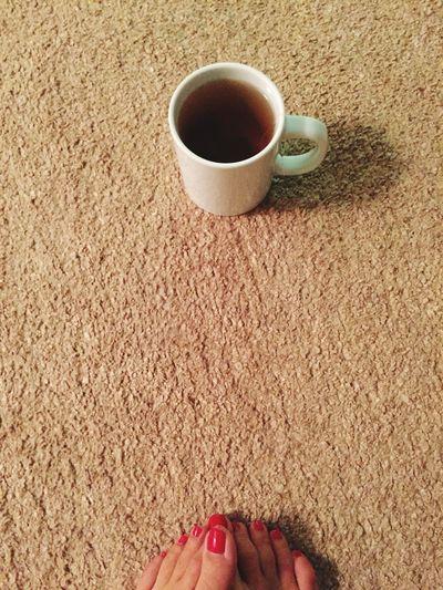 High Angle View Of Black Tea And Human Feet