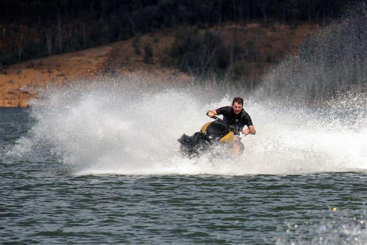 Man jet skiing in river