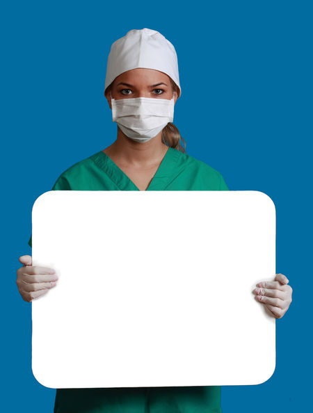 Young woman doctor keeping a white board, against a blue background. Copy Space Doctor  Healthcare Medicine Nurse White Board Adult Blue Blue Background Front View Green Color Health Healthcare And Medicine Keeping Looking At Camera Medical Cannabis Message One Person People Physician Placard Portrait Real People Studio Shot Surgical Mask