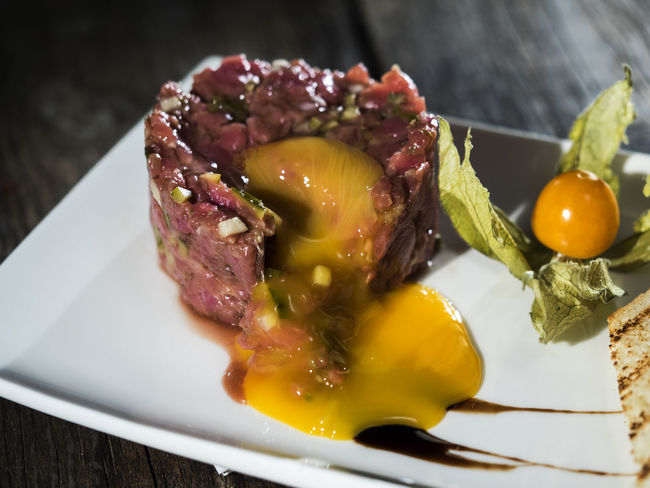 Raw steak tatar with egg yolk Close-up Day Egg Food Food And Drink Freshness Healthy Eating Indoors  Meat No People Plate Raw Ready-to-eat Serving Size Steak Table Tatar Yolk
