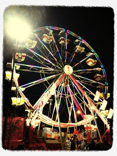 Neon candy-coated wheel in the sky! Carnival Spring Playing Family Time