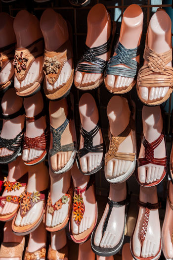 Close-up of shoes for sale at market stall