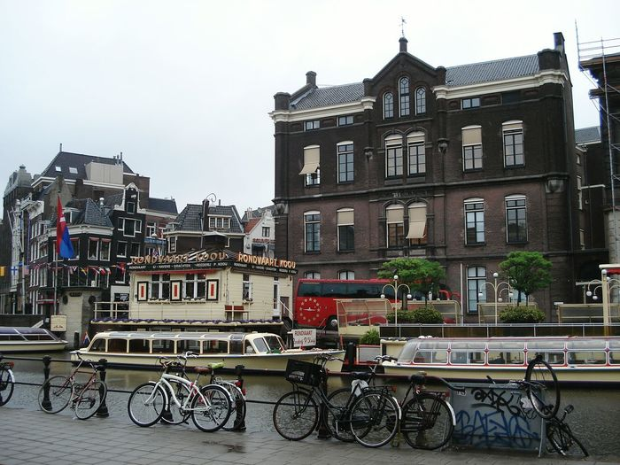 Your Amsterdam Showcase April Holland Boats City Life Houses Netherlands River Taking Photos Buildings Colorful Amesterdao Bicycles Bycicles Amsterdam City Bicycle Grey Sky