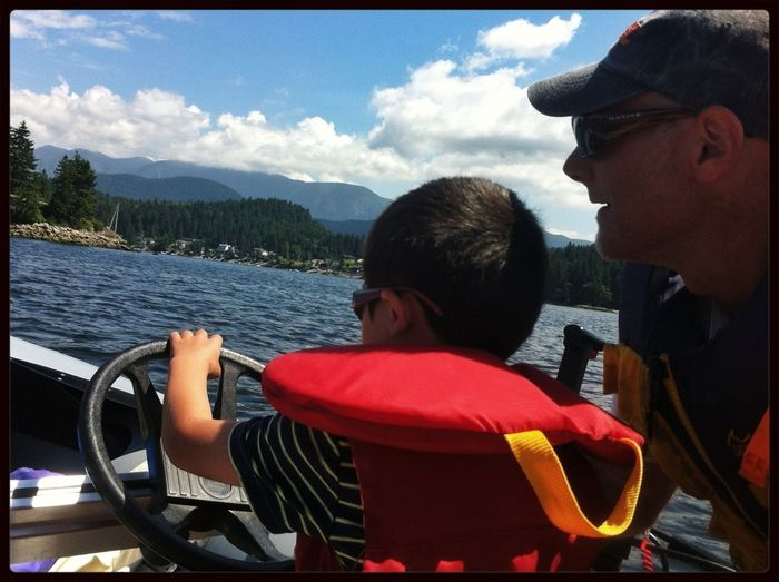 little e takes the wheel Father & Son Boating