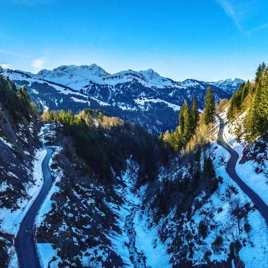 Mountain road in Damüls Dji Drone  Aerial View Austria Mountain Snow Nature Winter Beauty In Nature Scenics Tranquility Blue Landscape Outdoors Cold Temperature No People Tree Clear Sky Mountain Range Tranquil Scene Day Sky Shades Of Winter