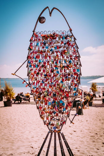 Close-up of multi colored umbrellas on beach