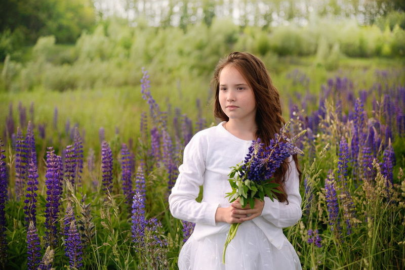 Agriculture Aromatherapy Beauty Beauty In Nature Blossom Day Field Flower Flowerbed Fragility Freshness Growth Lavender Lavender Colored Lifestyles Nature One Person Outdoors Plant Purple Rural Scene Springtime Wildflower Young Adult Young Women