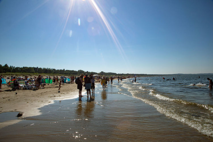 Baltic Sea Beach Crowd Day Group Of People Horizon Over Water Land Large Group Of People Leisure Activity Lens Flare Lifestyles Nature Outdoors Real People Sand Sea Sky Sun Sunbeam Sunlight Trip Vacations Water