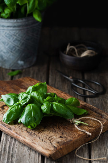 fresh basil on wooden cutting board   food photography Food Wood - Material Food And Drink Healthy Eating Vegetable Green Color Plant Part No People Still Life Close-up Rustic Cutting Board Basil Herb Food Photography Foodphotography Nikonphotographer Leaves Fresh