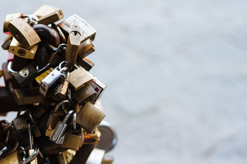Close-Up Of Padlocks On Railing By River