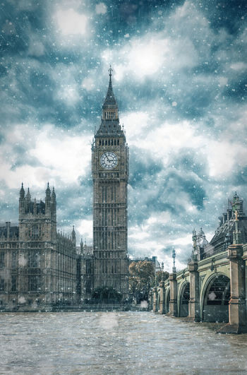Big Ben in London with snowfall and winter weather Architecture Architecture Blizzard City Clock Clock Tower Cold Temperature Dark Ice Landmark No People Outdoors River Sky Snow Tower Travel Travel Destinations Urban Skyline Weather Winter Winter