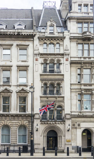 British architecture in parliament street, london with union jack flag flying.