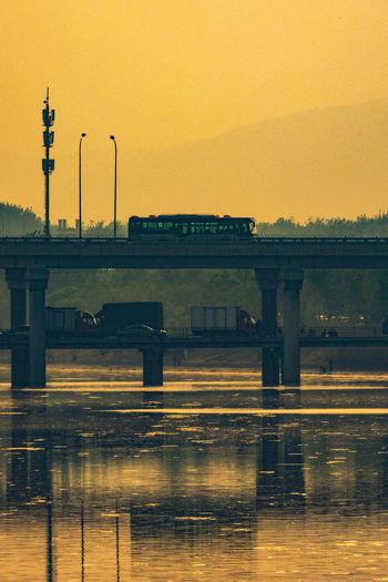 日出日入,车往车还,不移不改,只有西山。 sunset Water Reflection Bridge River Outdoors Dusk Transportation Cars Subset