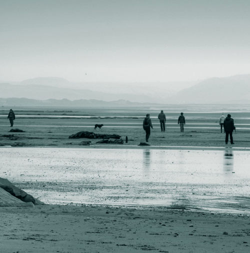 silence of the beach Mountains Bay Of Water Wales UK Beach Monochrome People Dog Reflections Stillness Calm Eerie Black And White Irish Sea Snowdonia Sandy Beach Low Tide Walking On The Beach Seaside Mist Range Of Mountains Mountain Range Grey