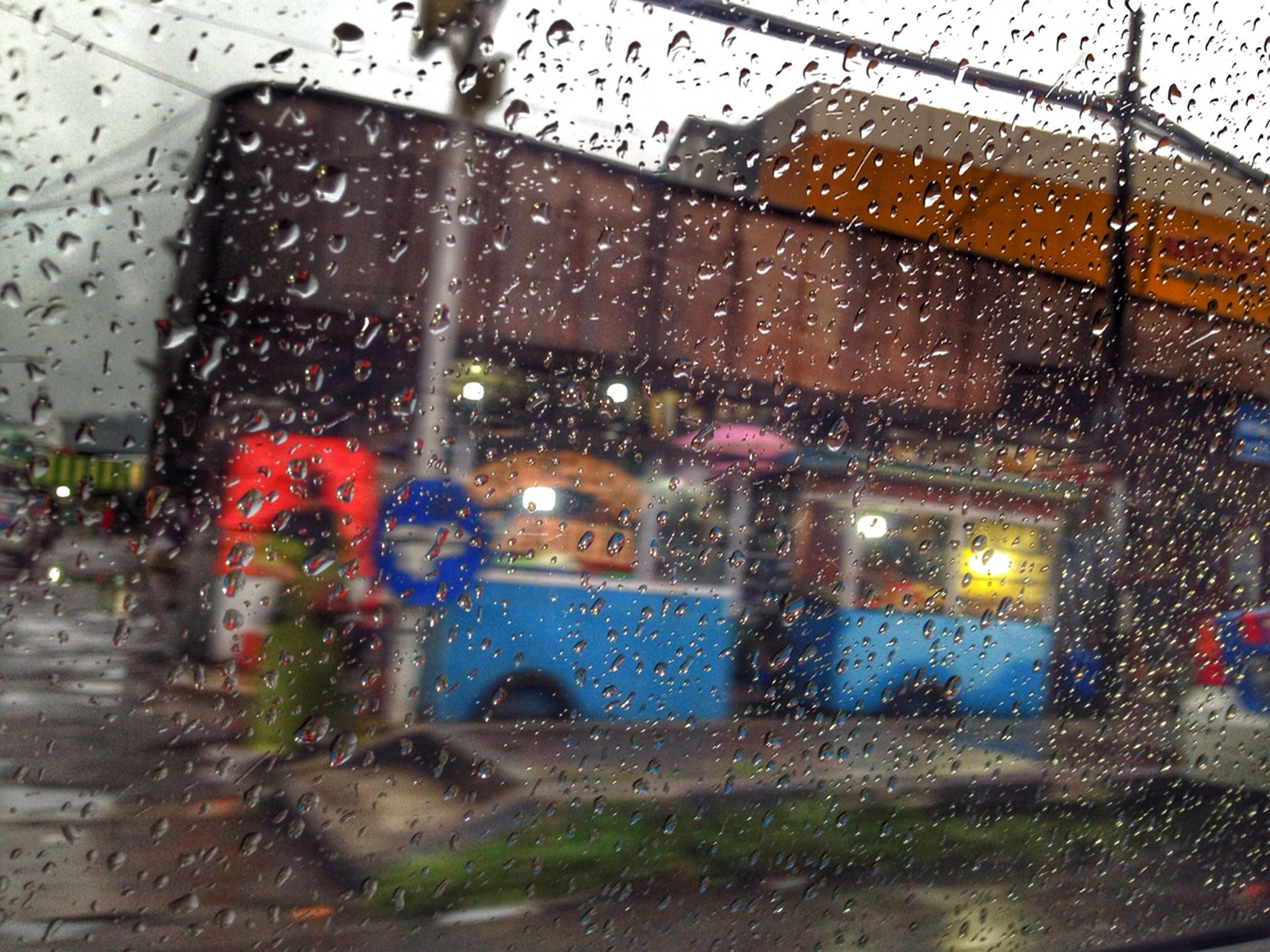 wet, window, rain, drop, transparent, transportation, glass - material, car, land vehicle, mode of transport, season, indoors, weather, water, raindrop, vehicle interior, windshield, street, road, car interior