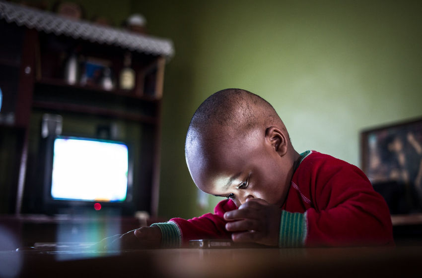Toddler on smartphone, in color Babyboy EyeEm Best Shots EyeEm Technology Mobile Phone Reflection The Week On EyeEm Addiction Concentration Deeply Inside Electronics  In Color Mobile Technology Playing Shaved Head Smartphone Technologie Technology Toddler  Toddlerlife Too Much