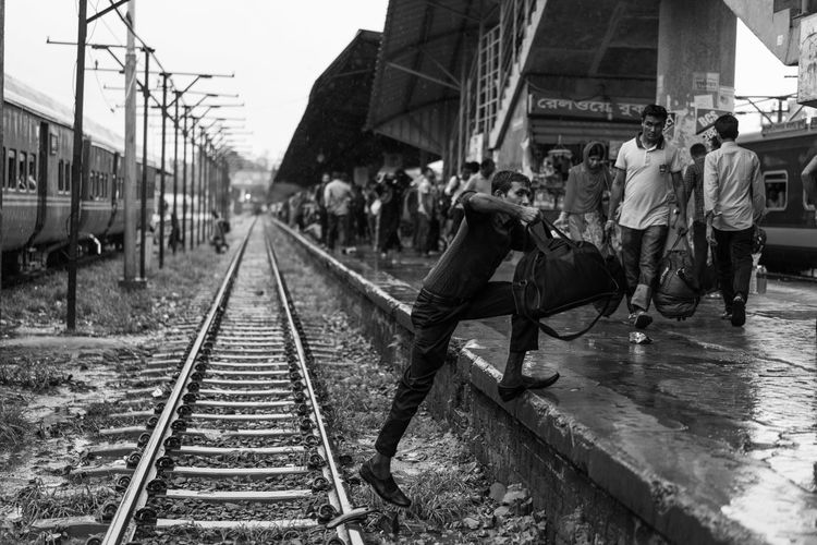 The Street Photographer - 2018 EyeEm Awards Architecture Built Structure Day Diminishing Perspective Direction Full Length Group Of People Men Mode Of Transportation People Public Transportation Rail Transportation Railroad Station Railroad Station Platform Railroad Track Real People The Way Forward Track Train - Vehicle Transportation Travel Waiting