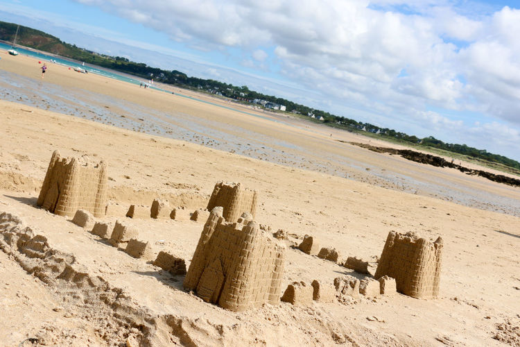 Sand Castles on a beach Beach Beauty In Nature Cloud Cloud - Sky Cloudy Day Idyllic Landscape Nature No People Non-urban Scene Outdoors Sand Sand Castle Scenics Shore Sky Tourism Tranquil Scene Tranquility Travel Destinations Vacations