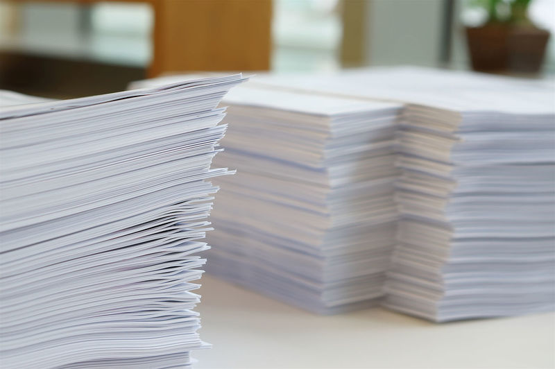 Stack of white papers sheet was organized on office background. Archives Business Busy Collection Concept Copy Data Desk Document Evidence File Finance Folder Form Heap High Letter Manage Many Note Office Order Organize Page Paper Paperwork Pile Report Research Sheet Stack Storage Stress Tall Up White Work Workaholic Workplace Write