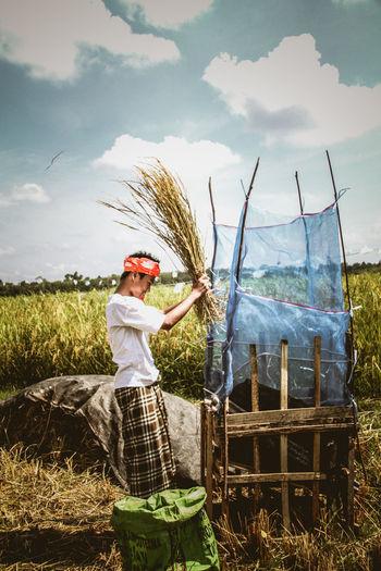 Side view of farmer working in farm
