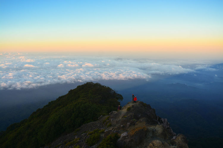 Climber and sunrise on mount raung