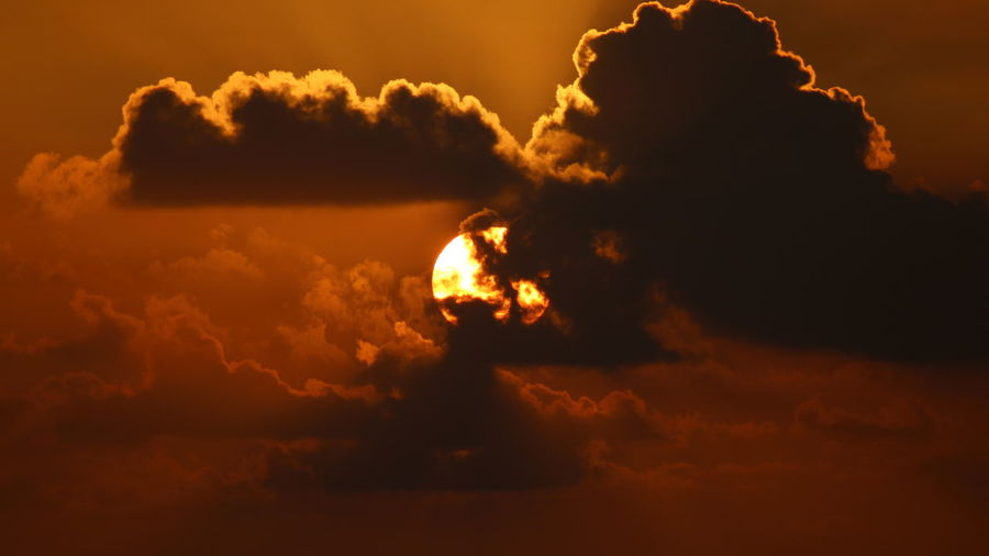Atmosphere Atmospheric Mood Beauty In Nature Cloud Cloud - Sky Cloudscape Cloudy Dramatic Sky Glowing Light Majestic Moody Sky Orange Color Outdoors Overcast Silhouette Sky Storm Cloud Sunset