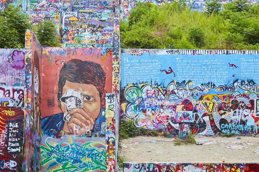 Graffiti Park at Castle Hill Architecture Art And Craft Craft Creativity Day Graffiti Human Representation Leisure Activity Male Likeness Multi Colored Mural One Person Outdoors Paint Real People Representation Street Art Teenager Text Wall Wall - Building Feature