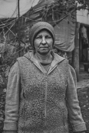 """""""In Exile"""" is a documentary portrait series of Molokans. Molokans are a Spiritual Christian religious group of Russian origin rejected more than two hundred years ago by Orthodox Church and exiled in the country of Georgia. They live in the east part of Georgia in the village of Ulianovka. After the collapse of the Soviet Union, many of them came back to Russia; also, their young generation left there to find a better job and lifestyle opportunity in the other parts of Georgia, and just a few of them(around 10 families) still live in this small territory. A small and old community which will be forgotten forever. Documentary Storytelling Blackandwhite Monochrome Female Daily Life Travel Places Village Real People Real Person Photography Life Style Life Georgia person Journalism Journey Human Body Part Human Face Human Representation Looking Woman Portrait Woman NaTaSha One Belief Rural Portrait Looking At Camera The Photojournalist - 2018 EyeEm Awards The Portraitist - 2018 EyeEm Awards The Traveler - 2018 EyeEm Awards"""