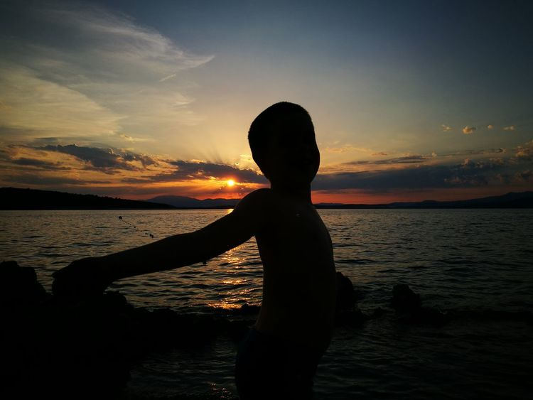Sunset Silhouette Water Reflection Vacations Beach Sea Child Beauty Nature Landscape Sky Beauty In Nature Outdoors Tranquility Summer EyeEmNewHere Croatia ♡ Vacations Croatia šilo Silhouette Orange Color I Love Sunsets I Love The Sea I LOVE MY FAMILY❤ Done That. Inner Power
