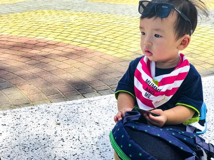 Cute baby People Kids ASIA Travel School Child Childhood One Person Real People Sitting Cute Lifestyles Babyhood Looking Leisure Activity Males  Innocence Toddler  Boys Looking Away Casual Clothing Day Full Length Outdoors
