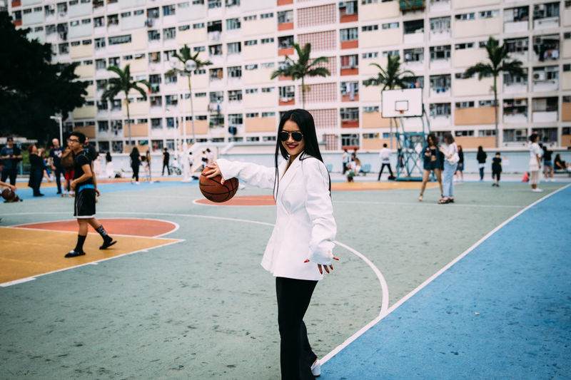 Sport Architecture Building Exterior Young Adult City Court Playing Incidental People Built Structure Day Leisure Activity People Motion Basketball - Sport Healthy Lifestyle Young Women Real People Adult Casual Clothing Exploring Fun Asian Girl Hong Kong The Portraitist - 2019 EyeEm Awards