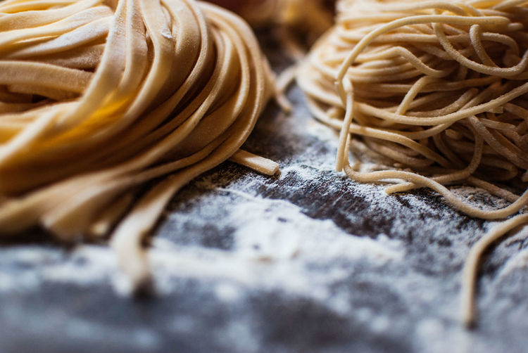 Close-Up Of Pasta With Flour On Table