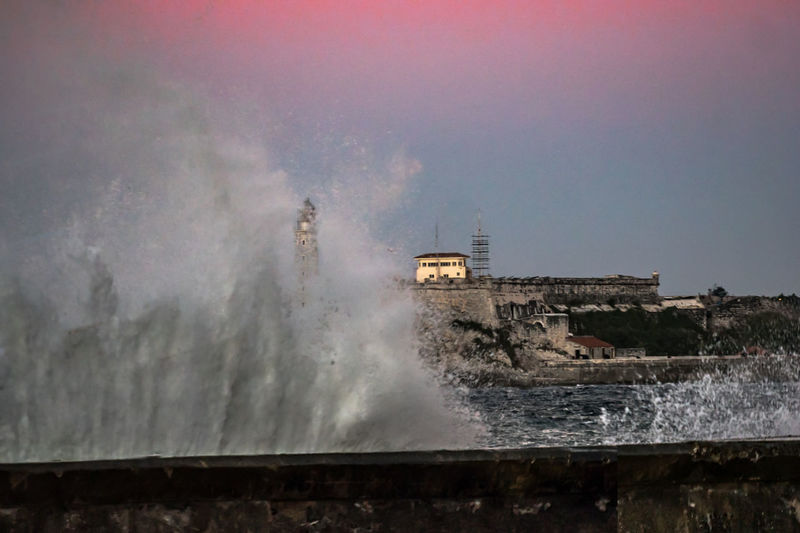 Castillo de la Punta from Malecon Edited Architecture Breaking Building Exterior Built Structure Crash Day Evening Force Hitting Merged Motion Nature Near Sunset No People Outdoors Photoshopped Power In Nature Sea Sky Splashing Spraying Water Wave