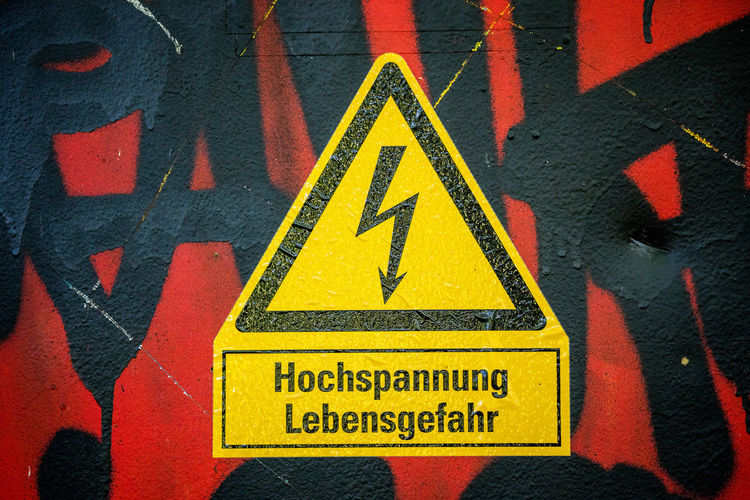 Close-Up Of Yellow High Voltage Sign