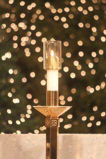 Altar candle and Christmas lights