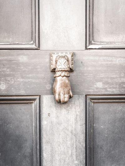 Close-up of sculpture on door