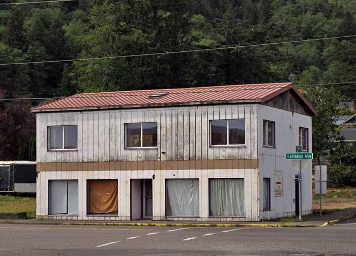 Old Building By Road In City