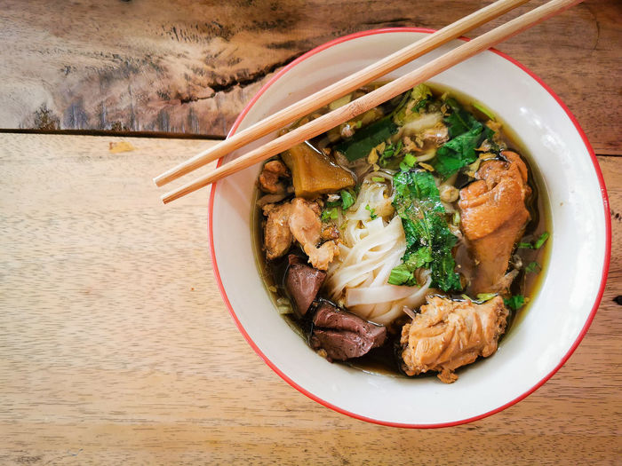 Rice noodles soup Eating Healthy Eating Bowl Delicious Homemade Food Thai Food Top View Food Asian Foods Stew Table Directly Above High Angle View Close-up Food And Drink Noodle Soup Noodles Chinese Food Japanese Food Soup Chopsticks Soup Bowl Ramen Noodles Served
