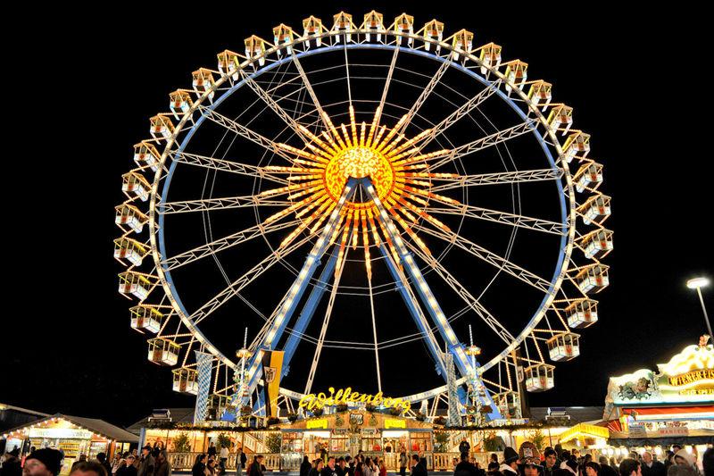Ferris wheel at funfair by night