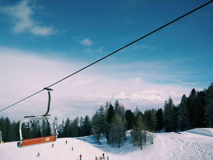 Ski lifts are fun Beauty In Nature Blue Cable Cloud Cloud - Sky Cold Temperature Covering Day Landscape Mountain Nature Non-urban Scene Outdoors Overhead Cable Car Scenics Season  Sky Snow Tranquil Scene Tranquility Tree Weather White White Color Winter