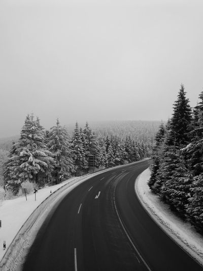 Road through the winterworld Thüringer Wald Winter Wonderland Thuringen Huawei Mate 9 Oberhof Blackandwhite Black And White Black & White Tree Road Winter Sky Landscape Winding Road Country Road Snow Covered Snowcapped Mountain Road Snow Highway