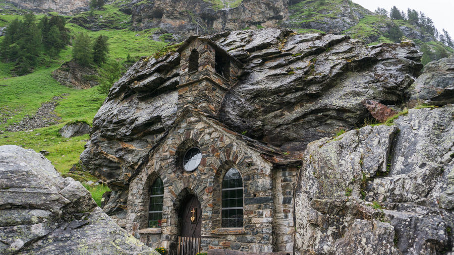 Low angle view of old building on rock